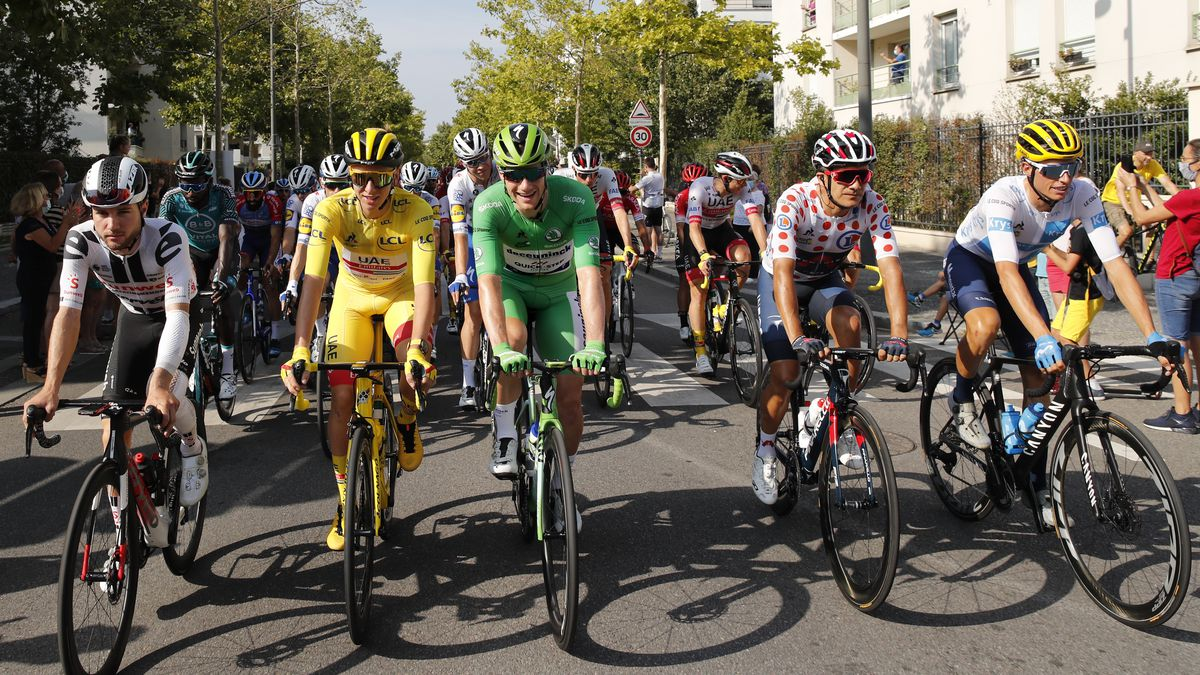 Tadej Pogacar of Slovenia, wearing the overall leader's yellow jersey, Richard Carapaz of...