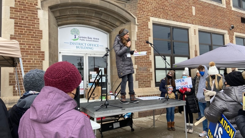 Parents and students protest in front of Green Bay Area Public School's main office wanting the...