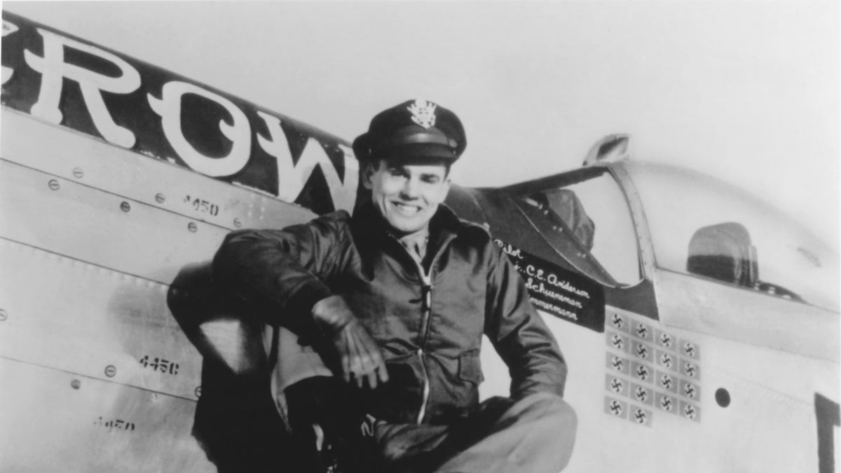 "WWII triple ace Clarence ""Bud"" Anderson on the wing of his P-51 Mustang ""Old Crow"" (public domain photo)"