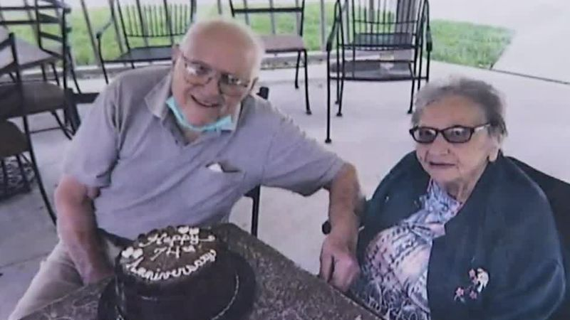 Photo of Don and Delores Kiesow with a cake celebrating their 74th wedding anniversary