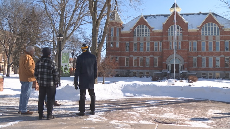 St. Norbert College President Brian Bruess joins a college tour on President's Day.