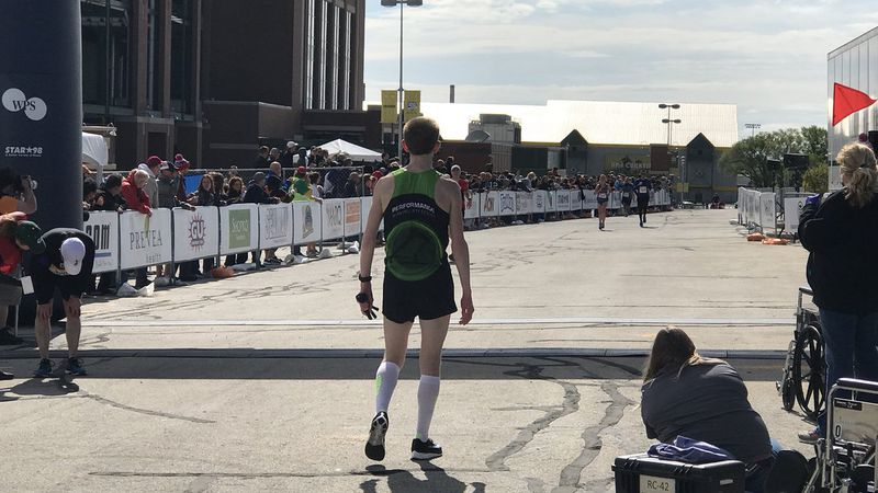 The winner of the 2018 men's division crosses the Cellcom Green Bay Marathon finish line...