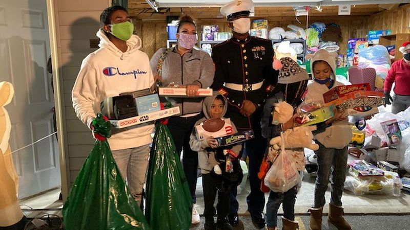 Nicole Skenandore (second from left), along with her children, and U.S. Marine Corps Staff...