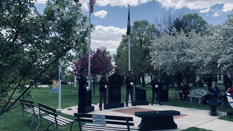 An Honor Guard stands watch over the Police and Fire Memorial in Fond du Lac.