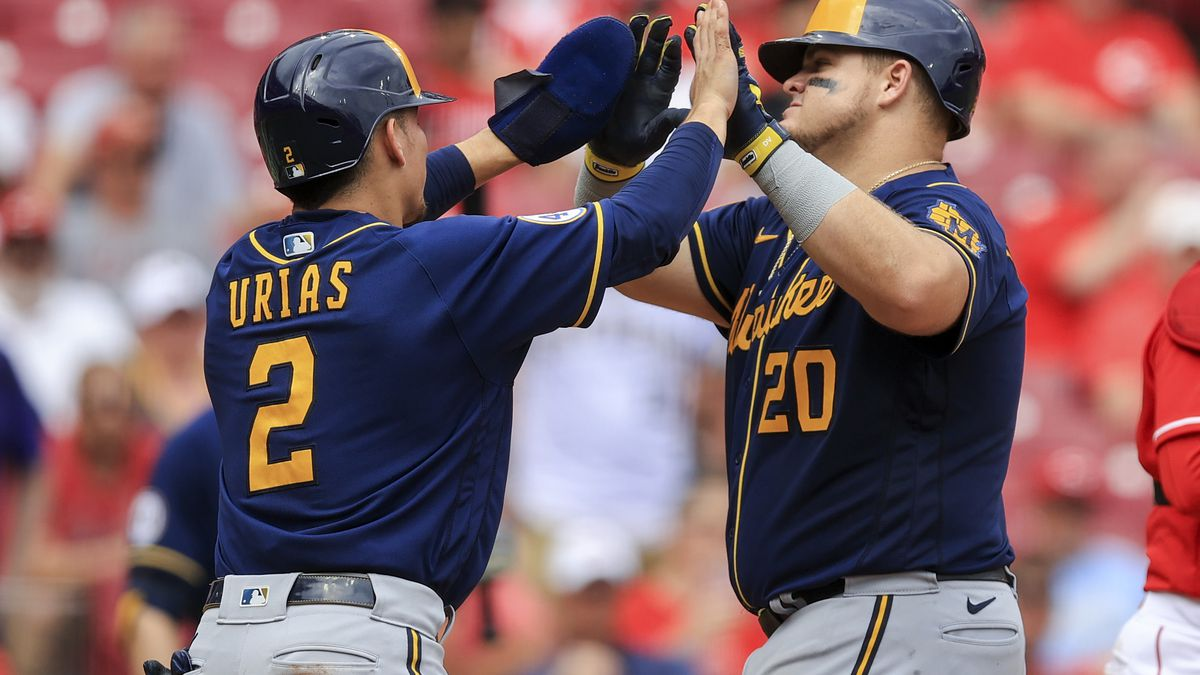Milwaukee Brewers' Daniel Vogelbach, right, high-fives Luis Urias after hitting a two-run home...