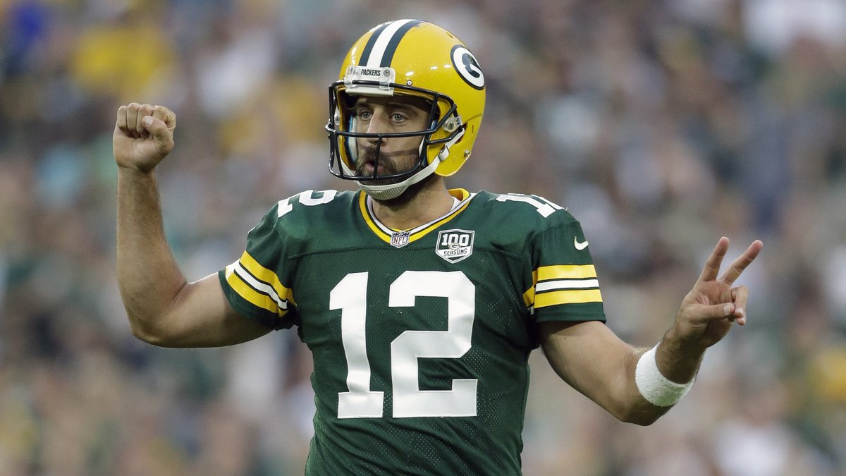 FILE - In this Aug. 16, 2018, file photo, Green Bay Packers' Aaron Rodgers gestures during the...