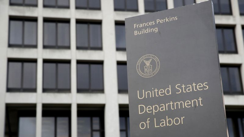 In this May 6, 2020 photo, a sign stands outside the Department of Labor's headquarters in...