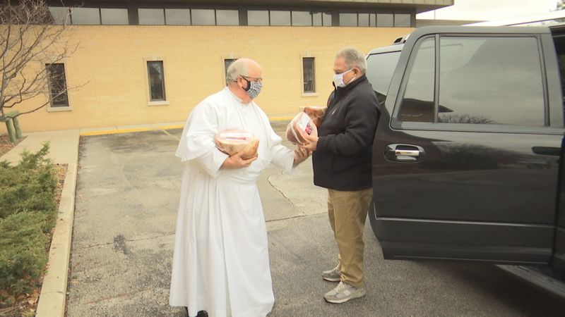 Kevin Burkel of Green Bay donated dozens of turkeys and hams to St. Willebrords Roman Catholic...