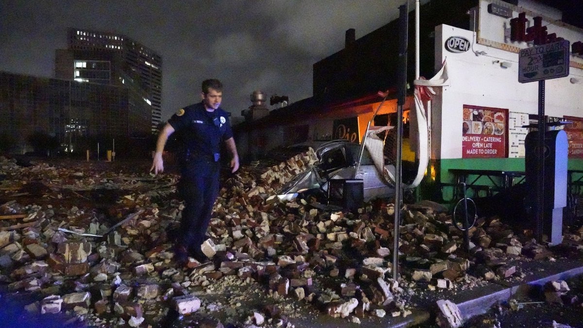 New Orleans Police detective Alexander Reiter, looks over debris from a building that collapsed...