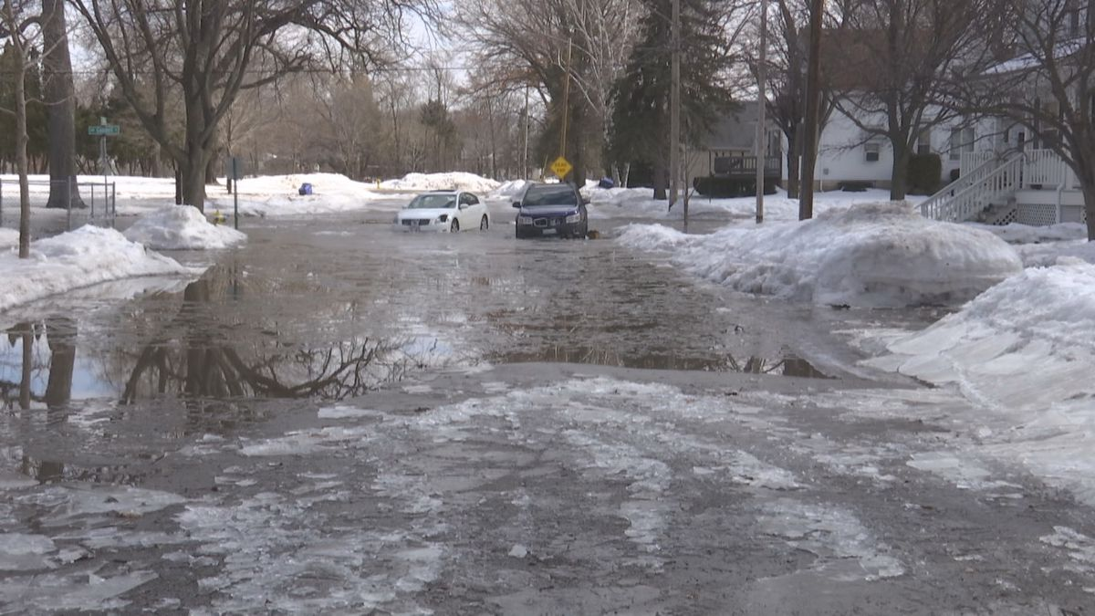 Cars stuck in the street after flooding in March along the East River (WBAY photo)