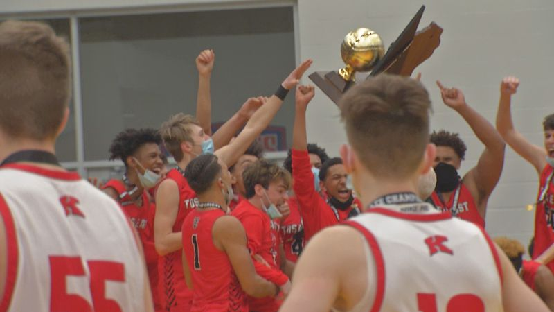 The Kimberly boy's basketball team looks on as Wauwatosa East raises the WIAA Division 1 State...