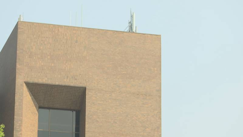 A Brown County 911 Communications Tower sits atop of the Cofrin Library located at the...