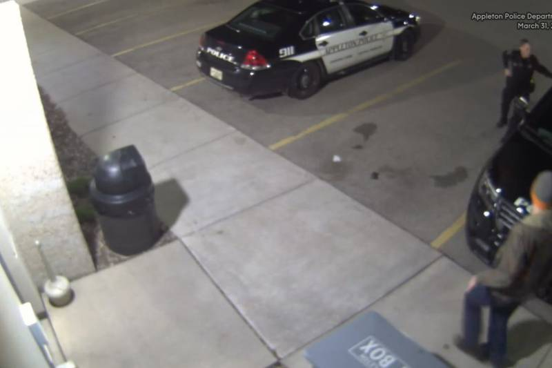 Video shows Appleton Police Lt. Ty West being confronted by an armed man outside the police...