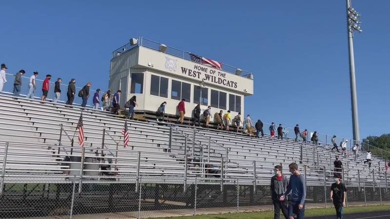 Students climb the bleachers to honor 9/11 victims