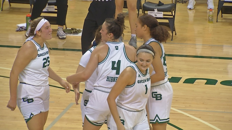 Caitlyn Hibner (4) celebrates in Green Bay's 69-61 win against Drake.