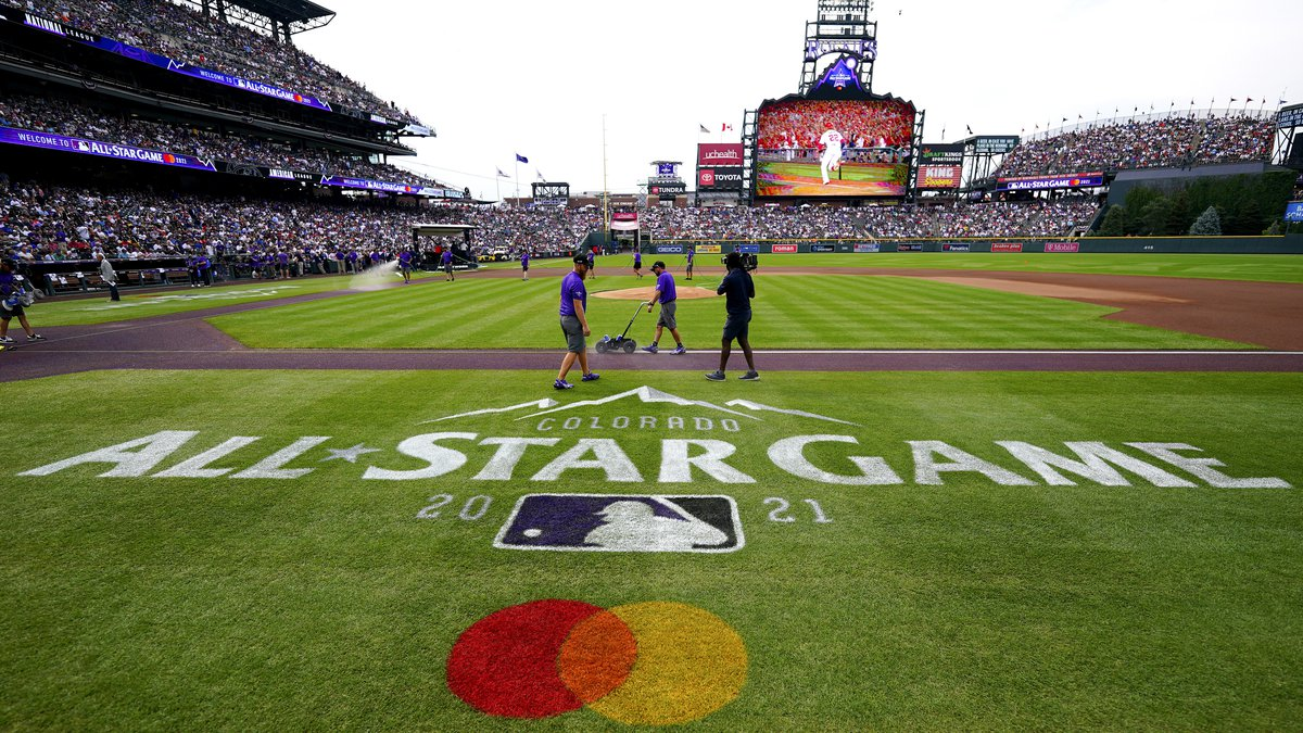The grounds crews prepares the field prior to the MLB All-Star baseball game, Tuesday, July 13,...