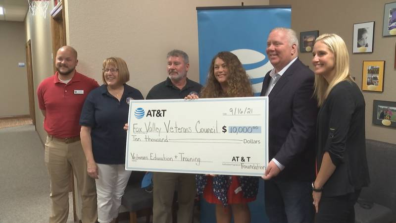 AT&T Wisconsin presents a $10,000 check to the Fox Valley Veterans Council.