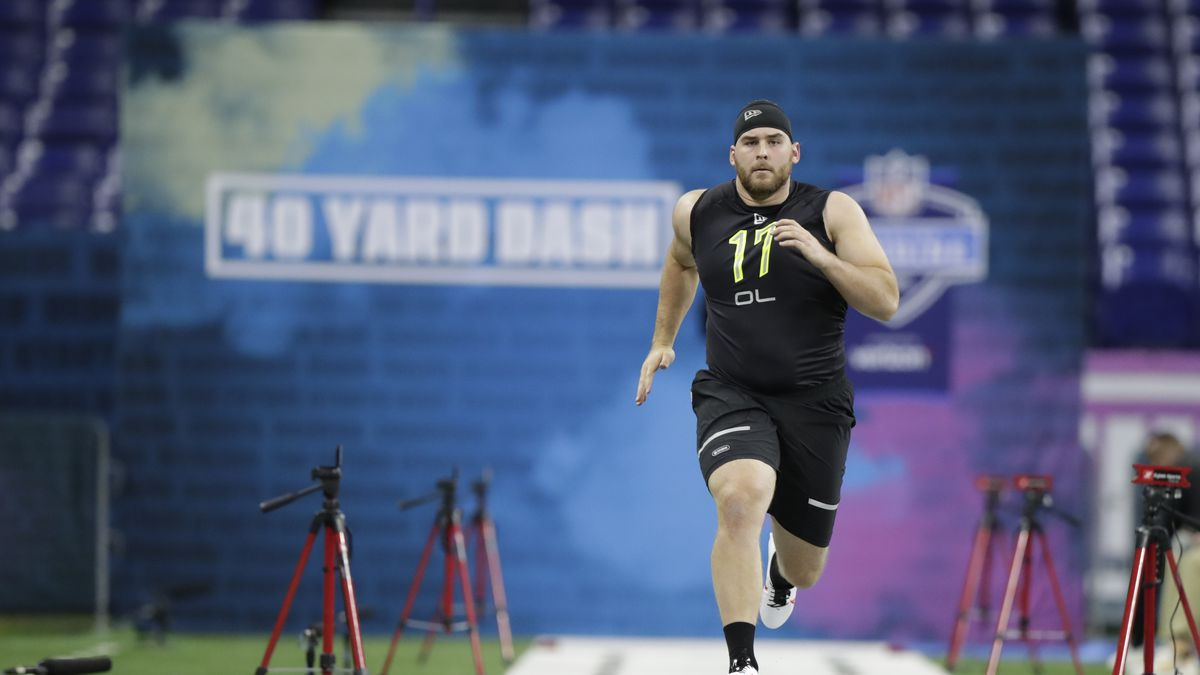 Oregon offensive lineman Jake Hanson runs the 40-yard dash at the NFL football scouting combine in Indianapolis, Friday, Feb. 28, 2020. (AP Photo/Michael Conroy)