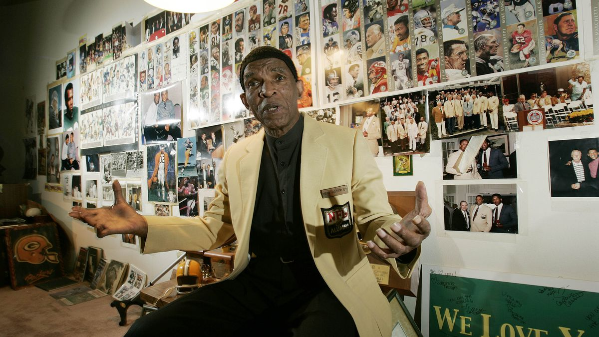 Former NFL player Herb Adderley sits in a room full of memorabilia of his playing days with the...