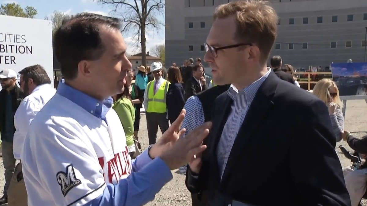 Gov. Scott Walker and Outagamie County Executive Tom Nelson get into a heated exchange about health care during the governor's visit to Appleton to promote tourism on May 5, 2017 (WBAY photo)