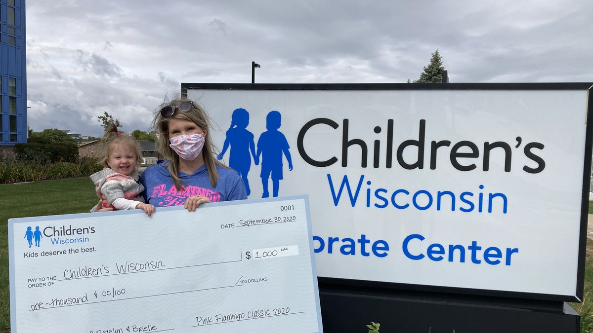 Action 2 News reporter Kristyn Allen and Braelyn present a check to Children's Wisconsin.