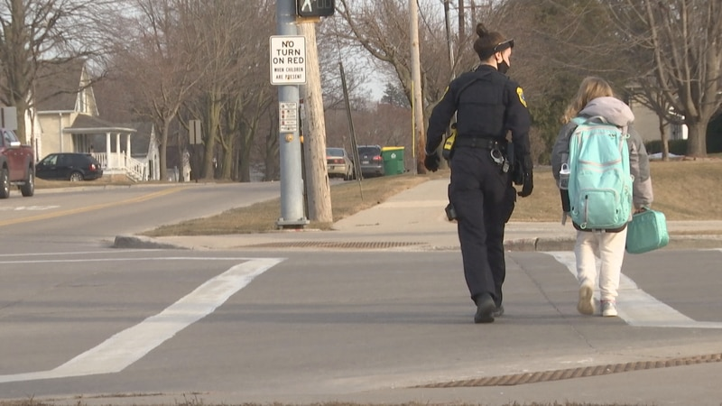 Green Bay Police Officer filling in as a crossing guard.