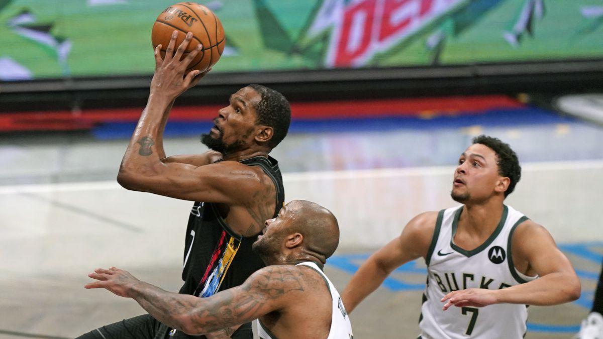 Brooklyn Nets forward Kevin Durant (7) goes up to shoot with Milwaukee Bucks forward P.J....