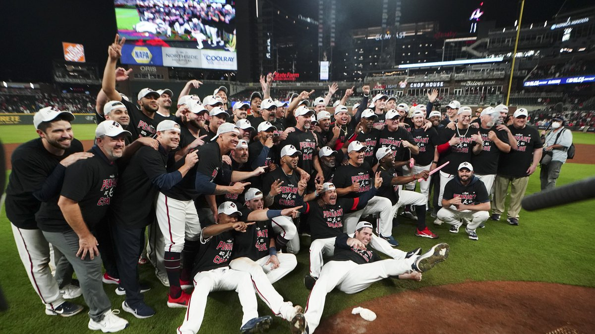 The Atlanta Braves pose fopr a photo after Game 4 of a baseball National League Division Series...
