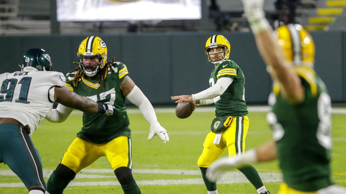 Green Bay Packers' Aaron Rodgers throws a pass during the first half of an NFL football game...