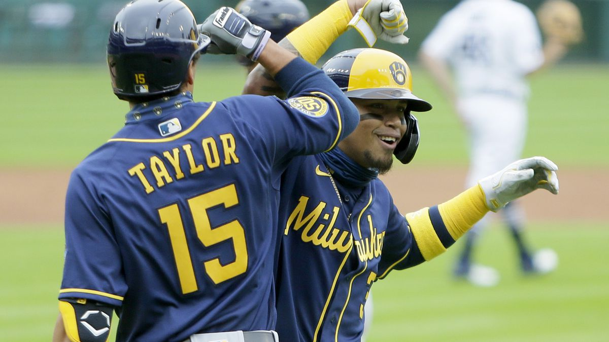 Milwaukee Brewers' Orlando Arcia (3) celebrates with right fielder Tyrone Taylor (15) after scoring against the Detroit Tigers on a double by Luis Urias during the second inning of a baseball game Wednesday, Sept. 9, 2020, in Detroit. (AP Photo/Duane Burleson)