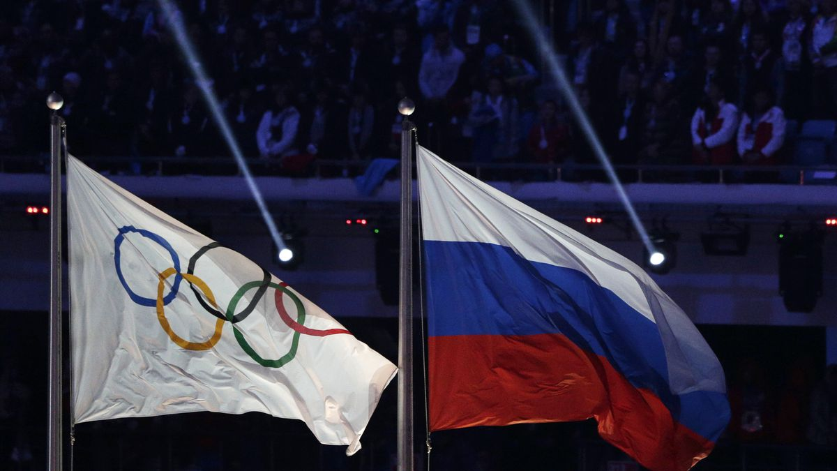 FILE - In this Feb. 23, 2014 file photo the Russian national flag, right, flies after it is...