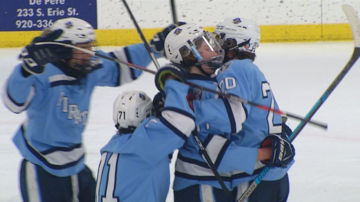 Bay Port hockey players celebrate after defeating De Pere 4-3 in the WIAA Regionals on Thursday night at Cornerstone Ice Arena.