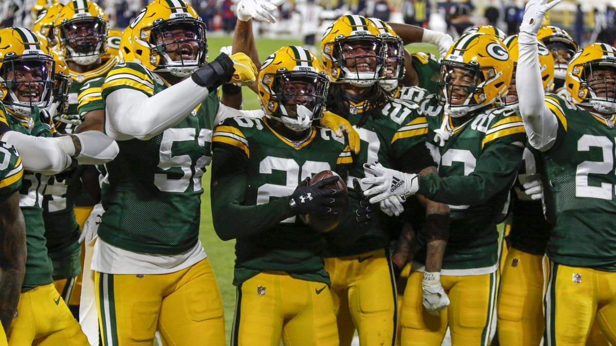 Green Bay Packers' Darnell Savage (26) celebrates his interception with teammates during the...
