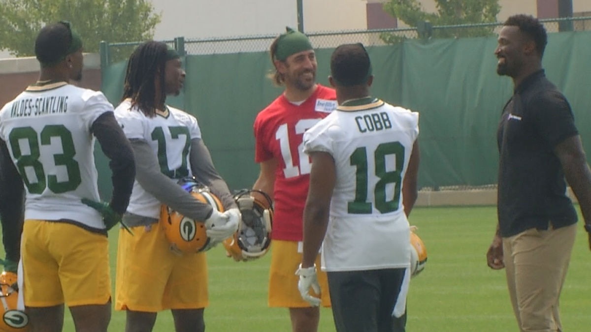 Former Packers receiver James Jones visits with Aaron Rodgers, Randall Cobb, Davante Adams and...