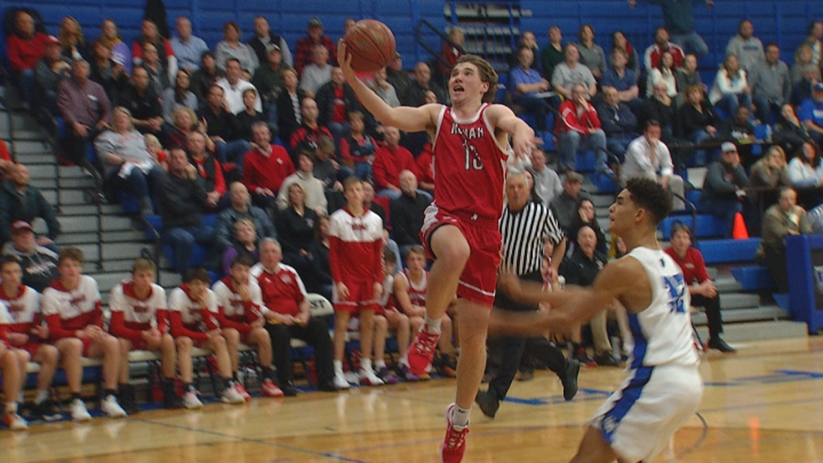 Neenah forward Bryce Henderson scores a layup in the Rockets 52-50 win against Oshkosh West on Monday night.