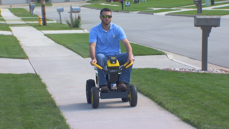 Inventor Adam Ford drives his ice Auger Machine in his De Pere neighborhood