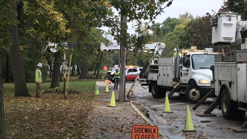 Crews work on part of the $50 million upgrade to the Neenah grid.
