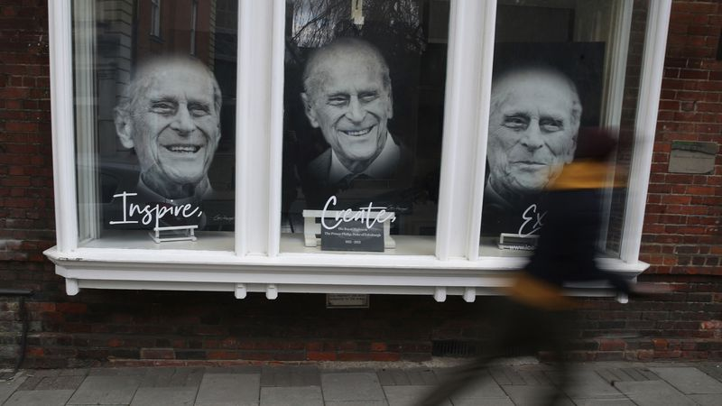 Portraits of Prince Philip are displayed in the window of an art gallery following the death of...