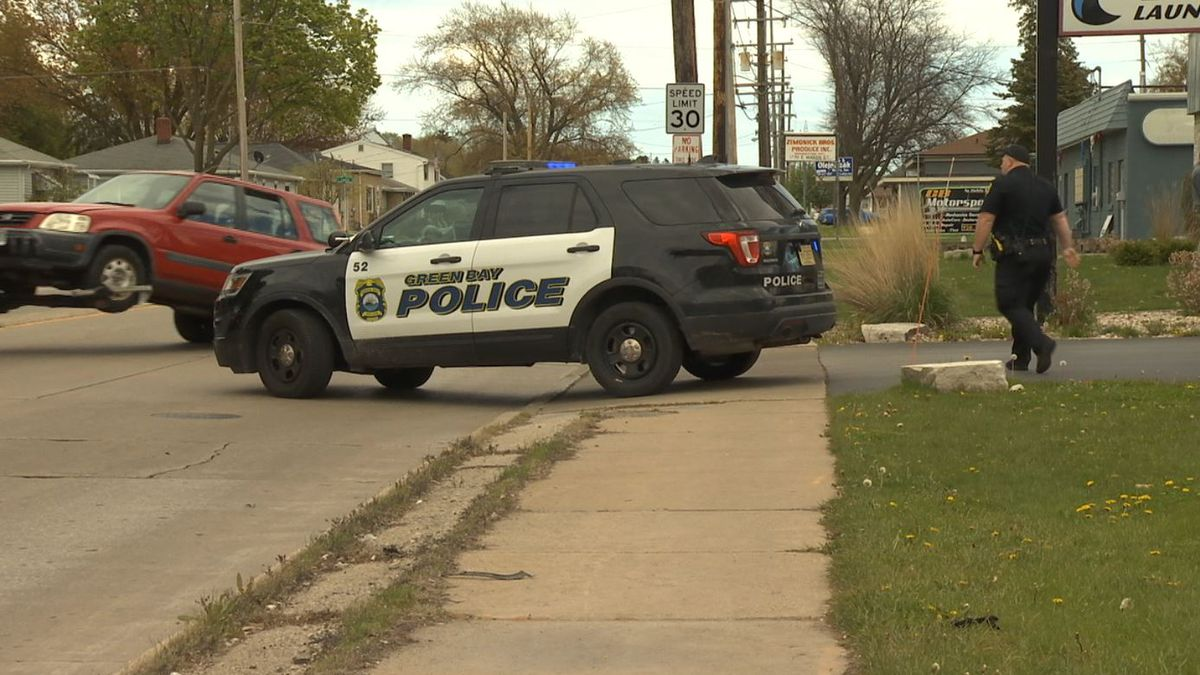Vehicle towed after hitting Green Bay pawn shop