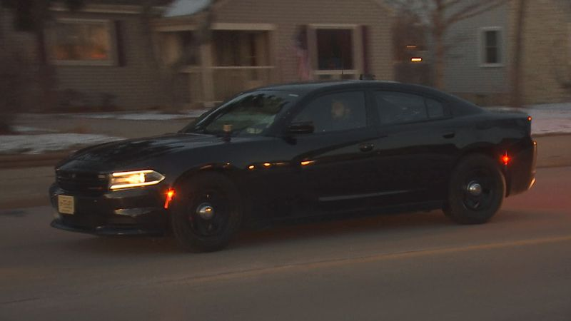 Green Bay Police Officer Kyle Harnish drives through the city as he works on the new Violent...