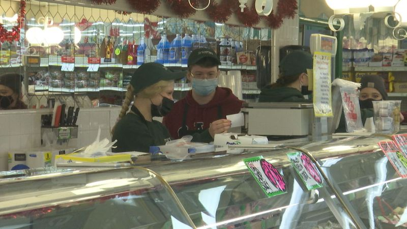 Employees at Austin's Grocery Store react to being eligible for the vaccine in March.