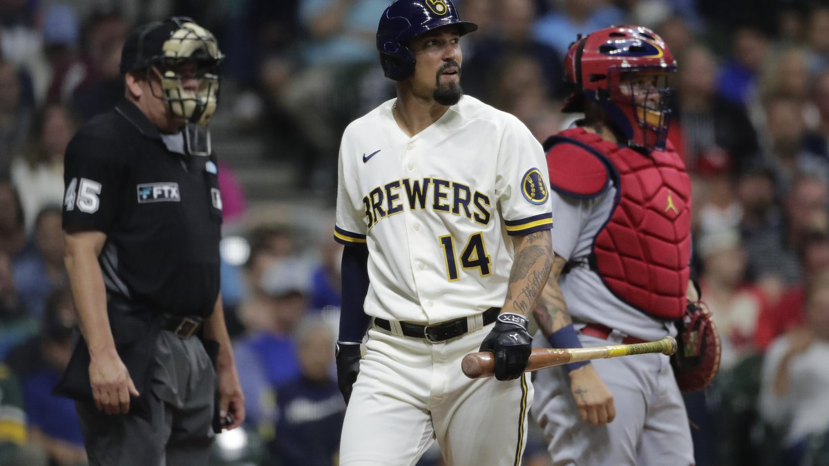 Milwaukee Brewers' Jace Peterson (14) reacts after striking out during the fifth inning of a...