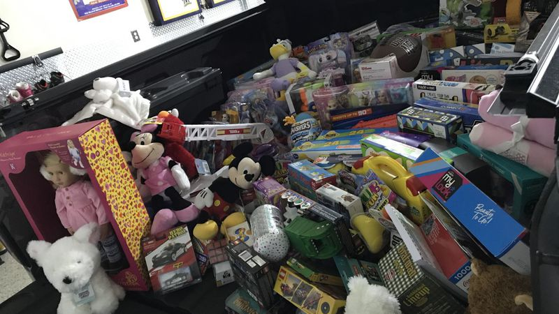 Toys donated by residents in the Parker Farms subdivision fill the bed of a pickup truck.