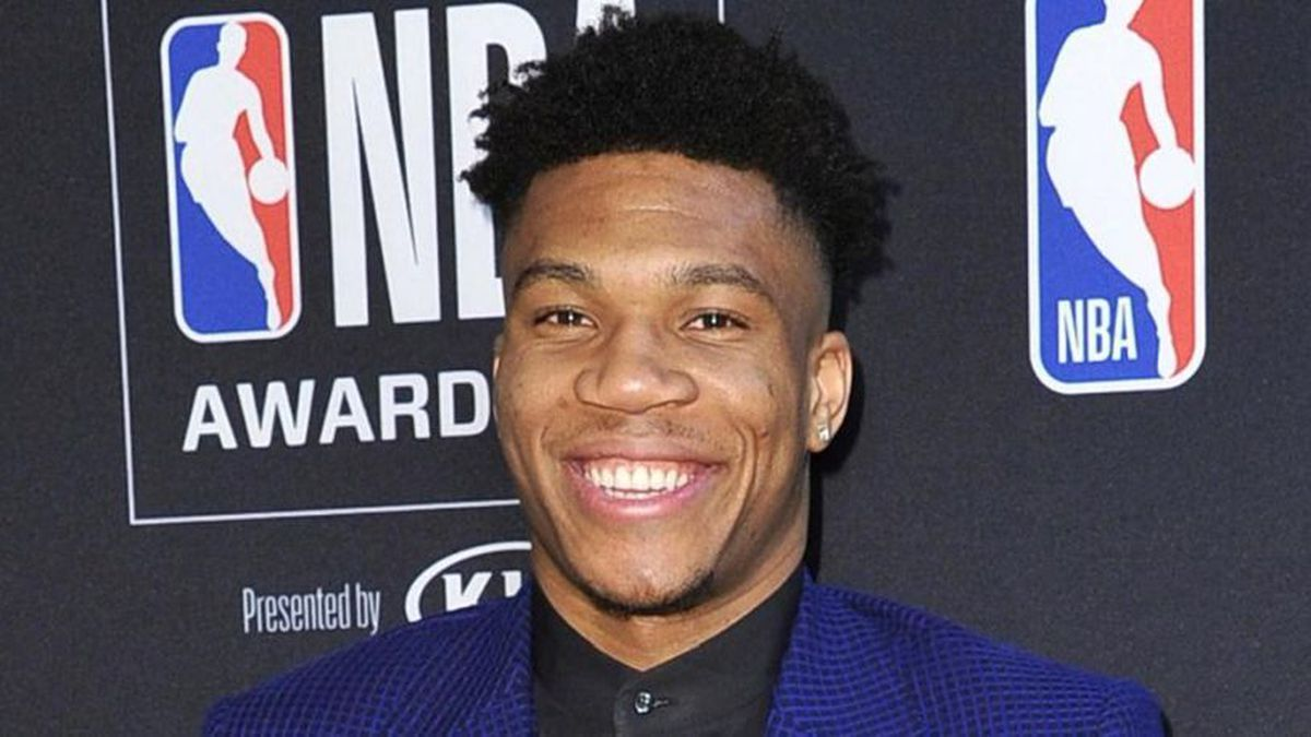 NBA player Giannis Antetokounmpo, of the Milwaukee Bucks, poses in the press room with most valuable player award at the NBA Awards on Monday, June 24, 2019, at the Barker Hangar in Santa Monica, Calif. (Photo by Richard Shotwell/Invision/AP)