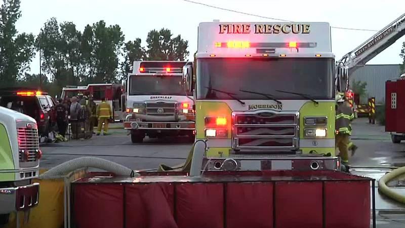 Fire trucks responding to New Hope UMC/Chicago Street Pub fire in Ledgeview on June 25, 2021