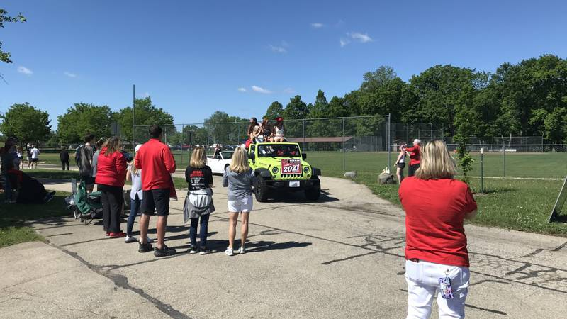 Members of Neenah's Class of 2021 parade around the high school campus one last time.