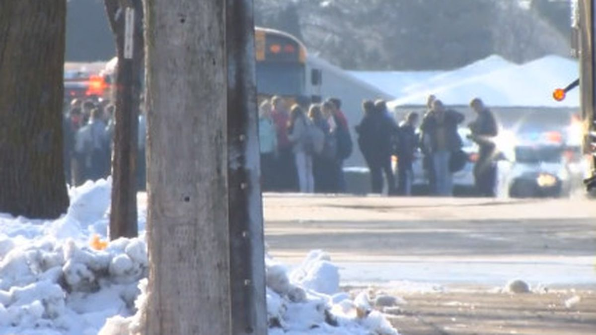 Students evacuated from Oshkosh West High School after an officer-involved shooting. (WBAY Photo)