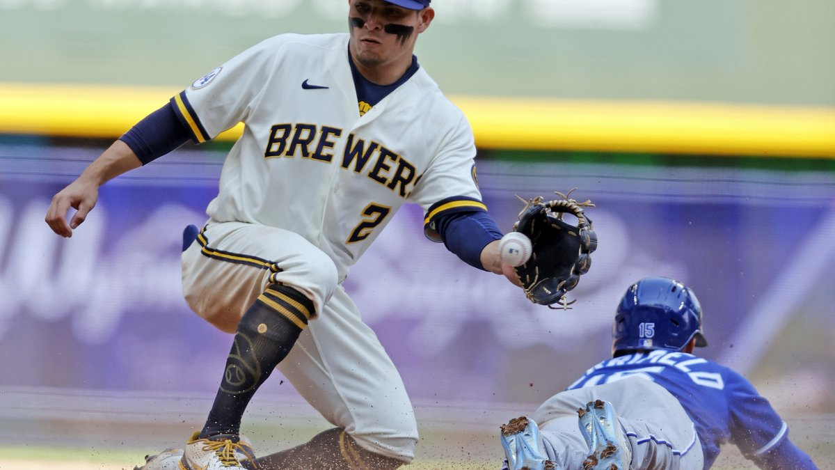 Kansas City Royals' Whit Merrifield steals second base ahead of the tag by Milwaukee Brewers'...