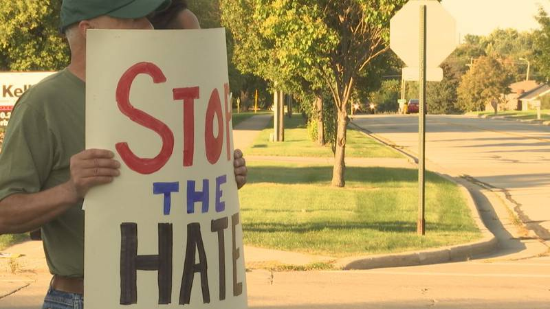 Protesters gathered outside the Rock Garden Wedding and Event Venue in Green Bay ahead of a...