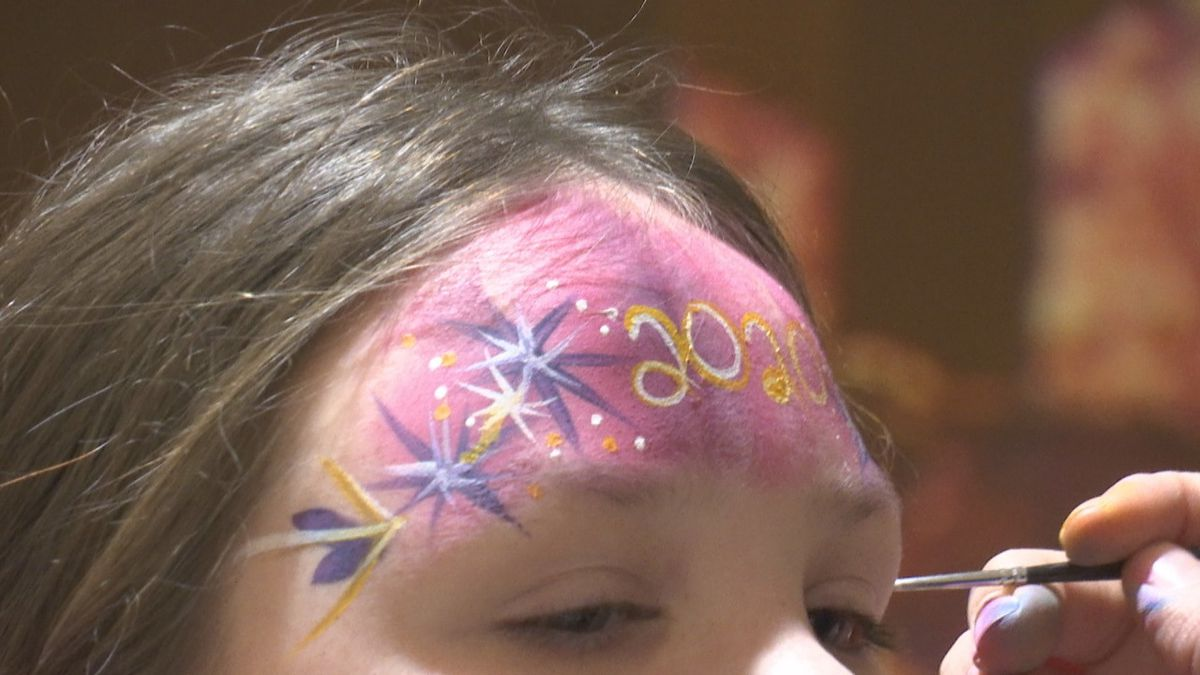 Face painting at the Ferguson YMCA in Green Bay for Rockin New Year's Eve bash.